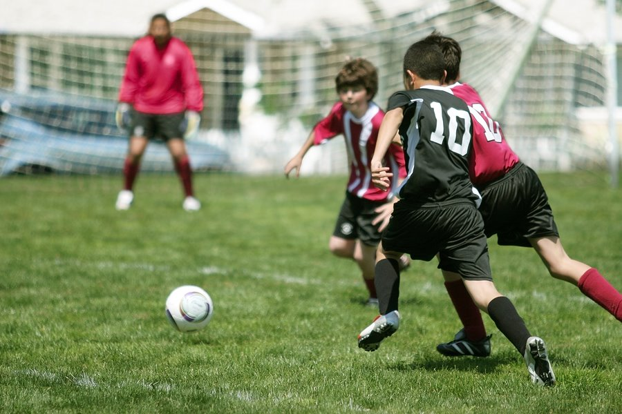 ... benefits young people can gain from participating in team sports